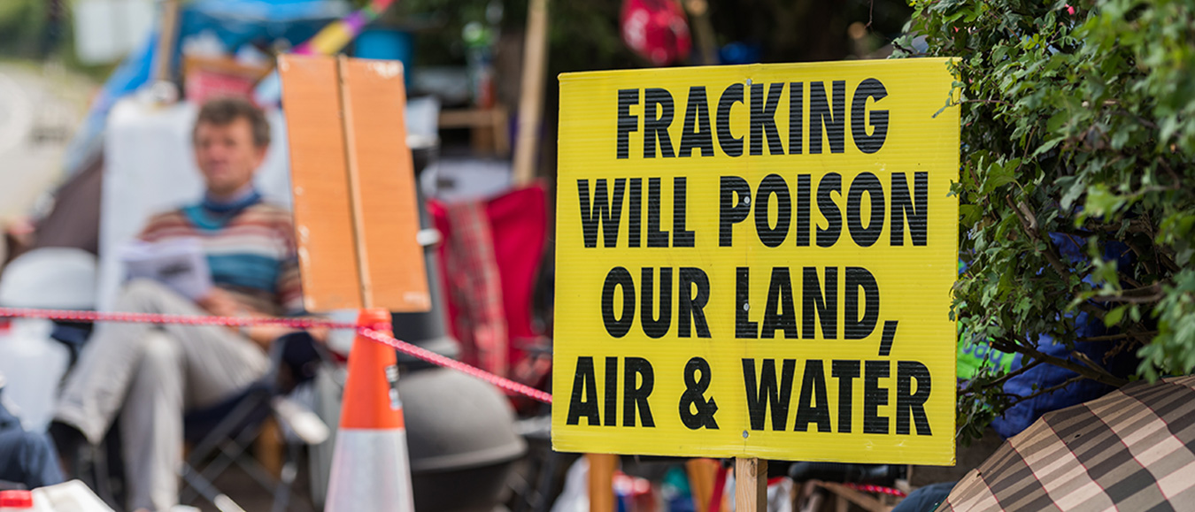 "Barton Moss fracking protest and sign saying ""Fracking will poison our land, air & water."