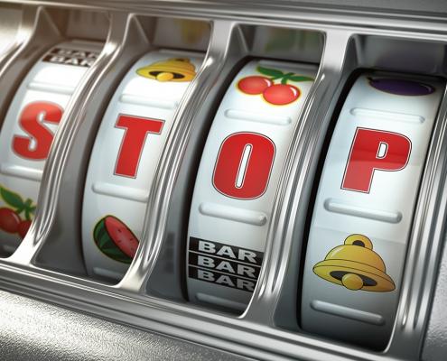 Fruit machine telling the gambler to stop.