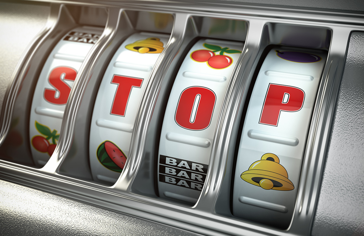 Fruit machine telling the gambler to stop.