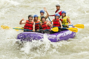 Teenagers white water rafting