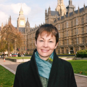 Caroline Lucas MP outside Parliament supporting drug law reform.
