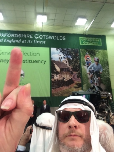 Chris Bovey takes a selfie sticking his middle finger up at David Cameron while in fancy dress as an Arab to protest at the selling of British weapons to Saudi Arabia.