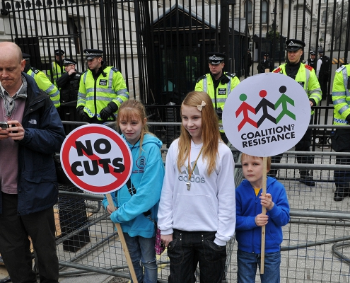 Family protesting against austerity cuts outside Downing Street.