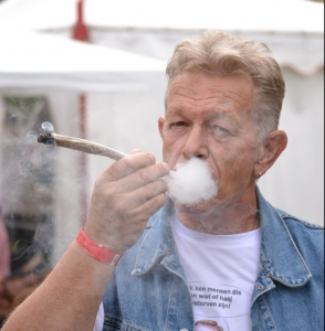 Photo of Nol van Schaik with a spliff.
