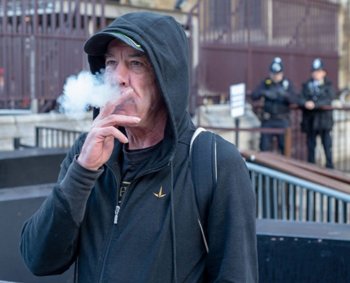 Photo of Jeff Ditchfield smoking cannabis at Parliament protest.
