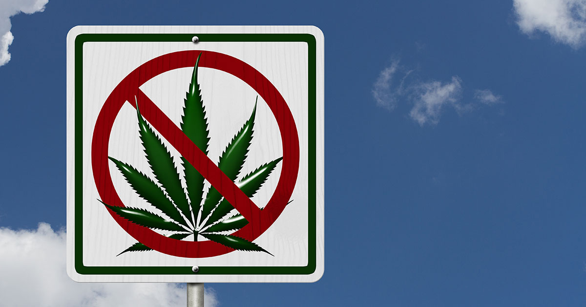 Photo of a sign depicting a marijuana leaf prohibited.