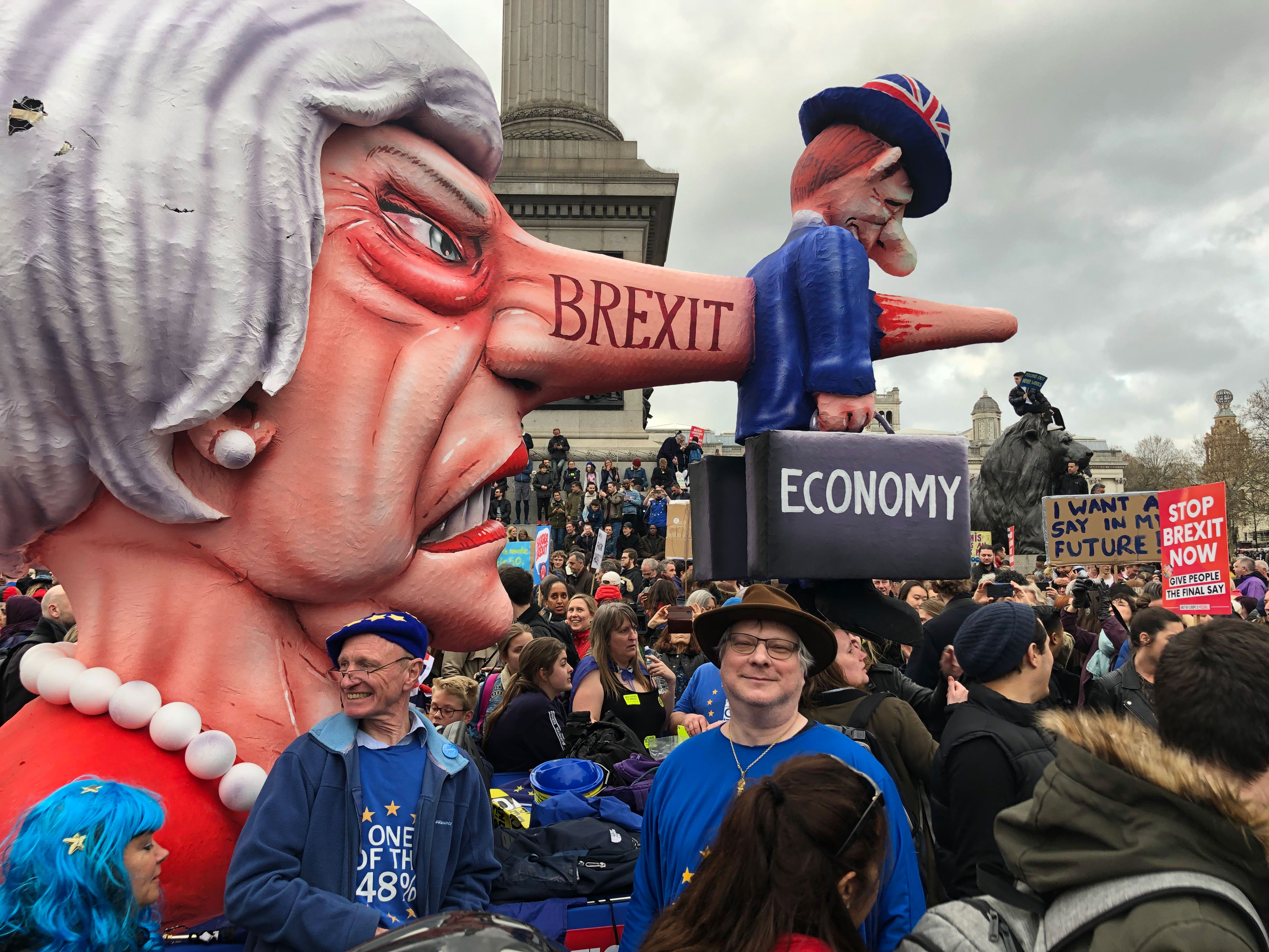 Chris Bovey posing with Theresa May sculpture made by Jacques Tilly in Trafalgar Square at the anti-Brexit protest, London, March 24 2019.