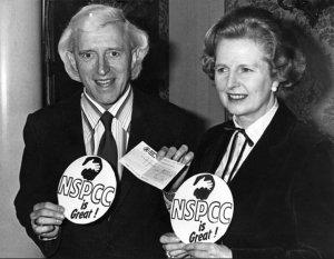 Margaret Thatcher with paedophile, Jimmy Savile, holding NSPCC badges.