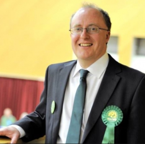 Mark Goache celebrating his election as the first ever Green Councillor to Colchester District Council.