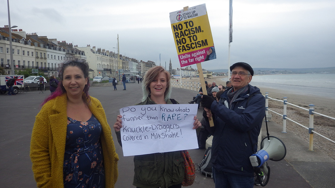 Anti-fascist campaigners on the seafront of Weymouth, Dorset, UK.