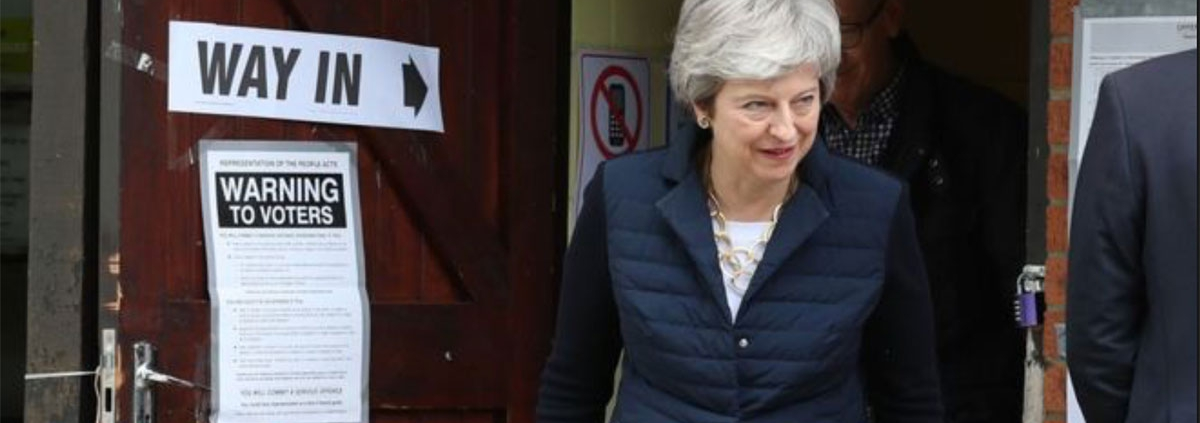 Theresa May at the polling station for the 2019 UK local elections.