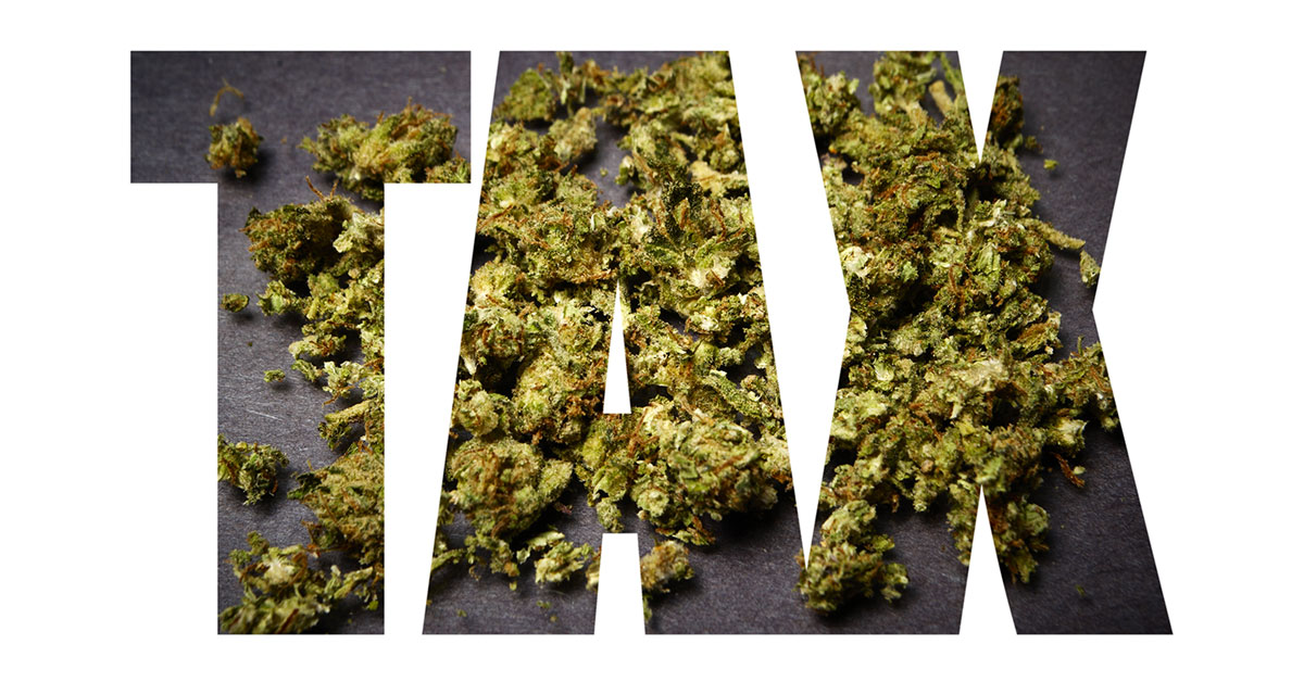 The word 'TAX' with cannabis buds imposed on the background.