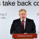 """Boris Johnson with the words: """"Let's take back control. By giving it all to me"""" in the background"""