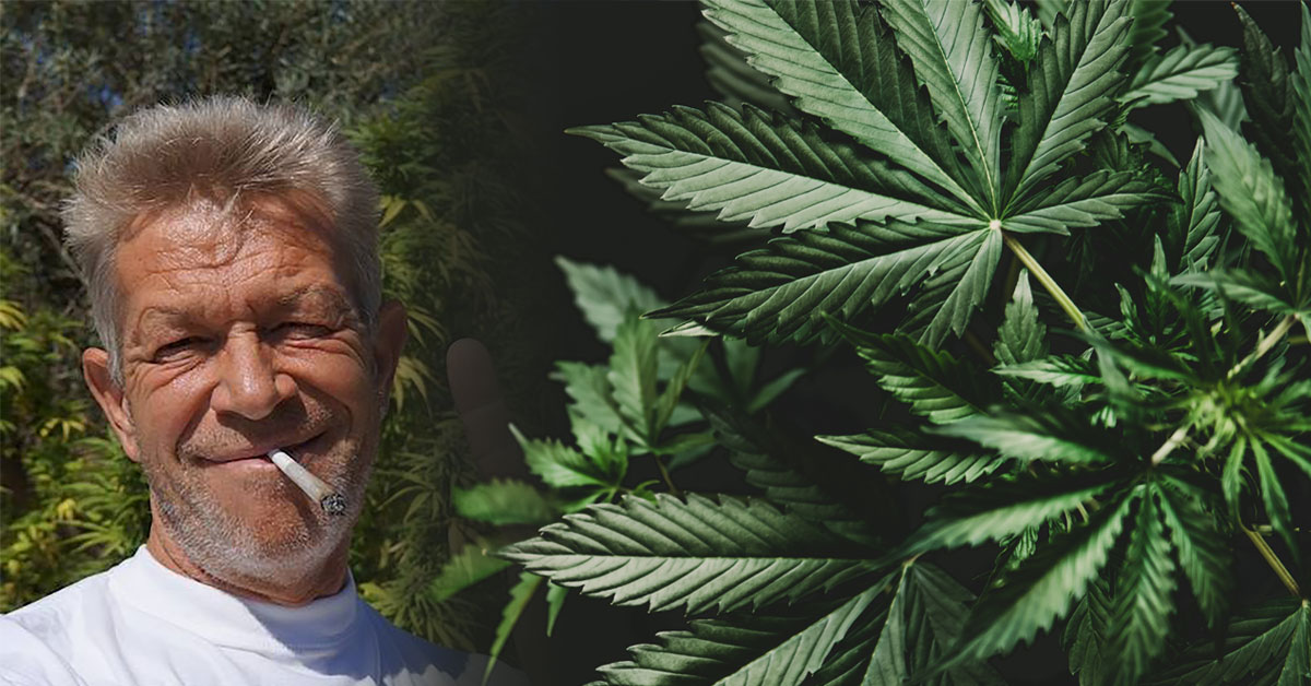 Cannabis activist and entrepreneur, Not Van Schaik, with cannabis plants in background.