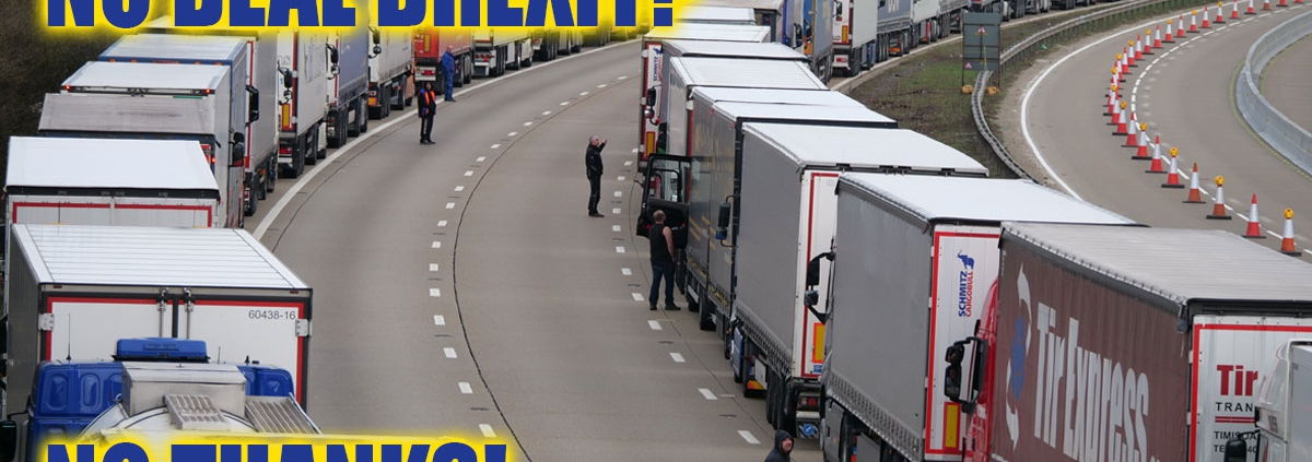 "A queue of lorries with the words ""NO DEAL BREXIT - NO THANKS""."