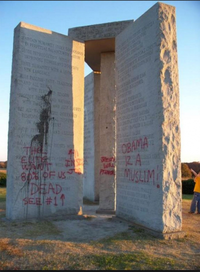 Photo of the vandalised Georgia Guidestones that claim they want the Earth's population to be half a billion.